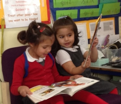 Children sharing a book